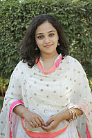 nithya-menon-smiling-photo-in-white-0